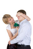 Woman does a gift to the husband. Royalty Free Stock Photos