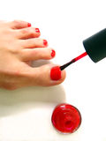The woman does a pedicure Stock Image