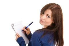 Woman does records by pen in notepad Stock Image