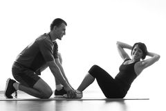 Woman does situps with coach Stock Photography