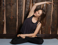 Woman does tilts Stock Photography