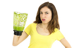 Woman doesn't like green smoothie Stock Images