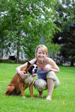 Woman with dog. The young woman with dog Stock Photo