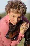 Woman with dog Stock Photos