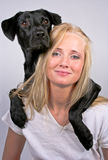 Woman with dog. Over her shoulder smiling Stock Images