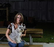Woman and a Dog. Woman with a Schnauzer on her lap Stock Image