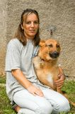 Woman with dog at the animal shelter of Lugano, Switzerland. Lugano, Switzerland - 15 September 2002: woman with dog at the animal shelter of Lugano on royalty free stock image
