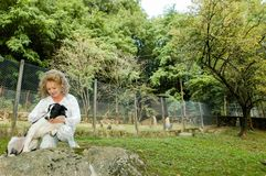 Woman with dog at the animal shelter of Lugano, Switzerland. Lugano, Switzerland - 15 September 2002: woman with dog at the animal shelter of Lugano on stock photos
