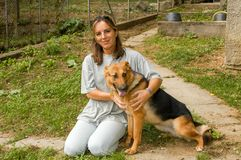 Woman with dog at the animal shelter of Lugano, Switzerland. Lugano, Switzerland - 15 September 2002: woman with dog at the animal shelter of Lugano on royalty free stock photos