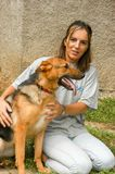 Woman with dog at the animal shelter of Lugano, Switzerland. Lugano, Switzerland - 15 September 2002: woman with dog at the animal shelter of Lugano on stock image