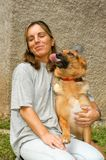 Woman with dog at the animal shelter of Lugano, Switzerland. Lugano, Switzerland - 15 September 2002: woman with dog at the animal shelter of Lugano on stock images