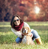 Woman with dog on the autumn glade Royalty Free Stock Photos