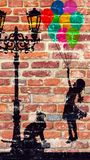 A little girl flies with balloons. Graffiti drawn on a brick wall, a little girl flies away with balloons; a cat looks at the little girl under a lampshade Stock Images