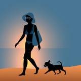 Woman and dog on the beach Stock Photos