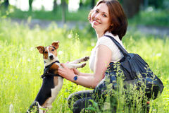 Woman with dog. Woman beautiful young happy with dark hai playing with small dog Jack Russell Terrier Royalty Free Stock Photo