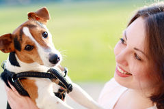 Woman with dog. Woman beautiful young happy with dark hair holding small dog Jack Russell Terrier Stock Images