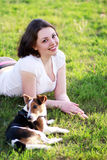 Woman with dog. Woman beautiful young happy with dark hair in striped sweater holding small dog Jack Russell Terrier Royalty Free Stock Photography