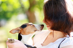 Woman with dog Stock Images