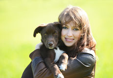 Woman with dog. Beautiful young woman holding small cute dog Royalty Free Stock Image