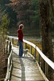 Woman and Dog on Boardwalk in Autumn Royalty Free Stock Photo