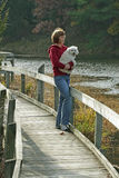 Woman and Dog on Boardwalk in Autumn Stock Images
