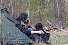 Woman with a dog camping Stock Images