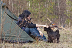 Woman with a dog camping Royalty Free Stock Image