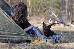 Woman with a dog camping Royalty Free Stock Photography