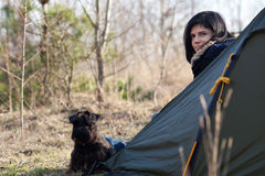 Woman with a dog camping Stock Photo