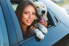 Woman and dog in car. Vacation with pet concept. Royalty Free Stock Photo