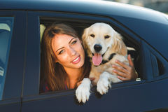 Woman and dog in car. Vacation with pet concept. Royalty Free Stock Photos