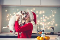 Woman with dog at christmas hat Stock Image