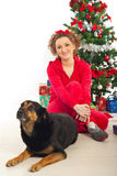 Woman with dog by Christmas tree Stock Photos