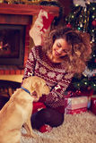 Woman with dog for Christmas Stock Photo