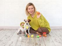 Woman and dog color Easter eggs Stock Photo