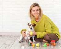 Woman and dog color Easter eggs Royalty Free Stock Photo