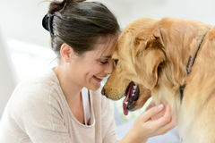 Woman and dog cuddling Royalty Free Stock Image
