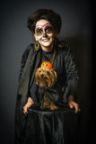 Woman and dog in disguise for Halloween. Portrait of woman and dog in disguise for Halloween Royalty Free Stock Image