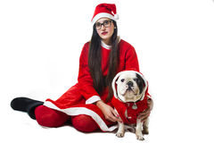 Woman and dog dressed in santa claus Stock Image