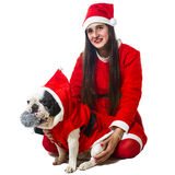 Woman and dog dressed in santa claus Royalty Free Stock Images