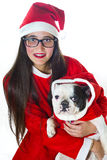 Woman and dog dressed in santa claus Royalty Free Stock Photography