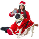 Woman and dog dressed in santa claus Royalty Free Stock Image
