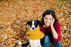 Woman and dog enjoying autumn season together Royalty Free Stock Photo