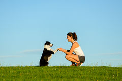 Woman and dog enjoying tranquility outdoor Royalty Free Stock Images