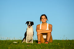 Woman and dog enjoying tranquility outdoor Stock Photo