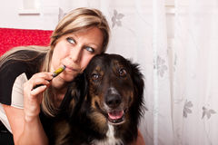 Woman with  dog evaporated E Cigarette Stock Image
