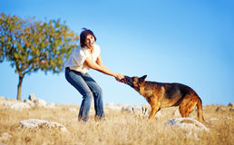 Woman with dog in a field Royalty Free Stock Images