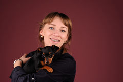 Woman with dog on the hands Royalty Free Stock Images