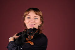 Woman with dog on the hands Royalty Free Stock Photography