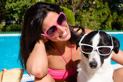 Woman and dog having fun on summer vacation Royalty Free Stock Photo